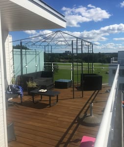 Penthouse i 3 plan, med 50m2 super tagterrasse. - Huoneisto