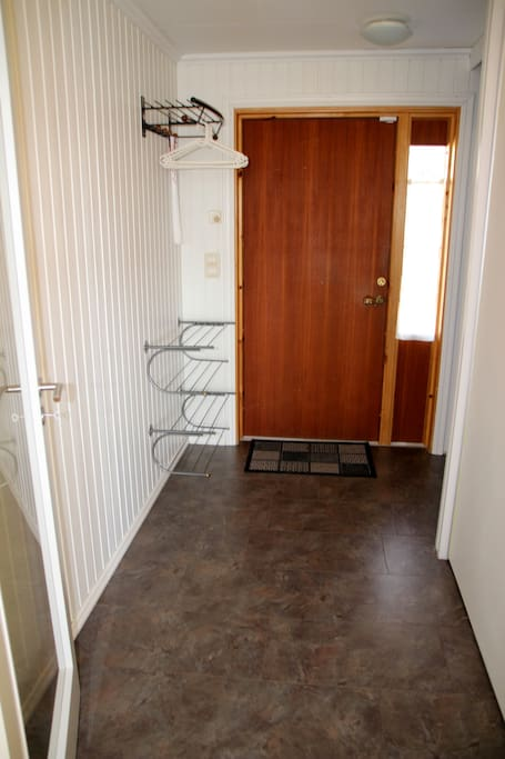 Spacious hallway with a loot of room for clotes and shoes.