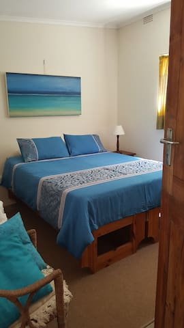 Bedroom 4, which has 1 x Queen bed, with an optional Single added for kids
