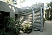 Louvered shutters offer all the privacy for your outside shower.