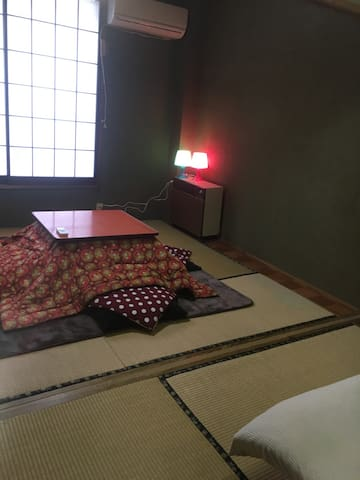 2nd floor bed room with Japanese Kotatsu table.