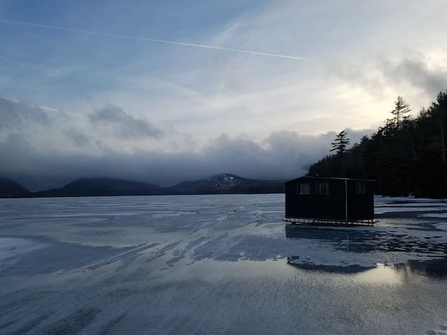Ice fishing on a lake near Acadia