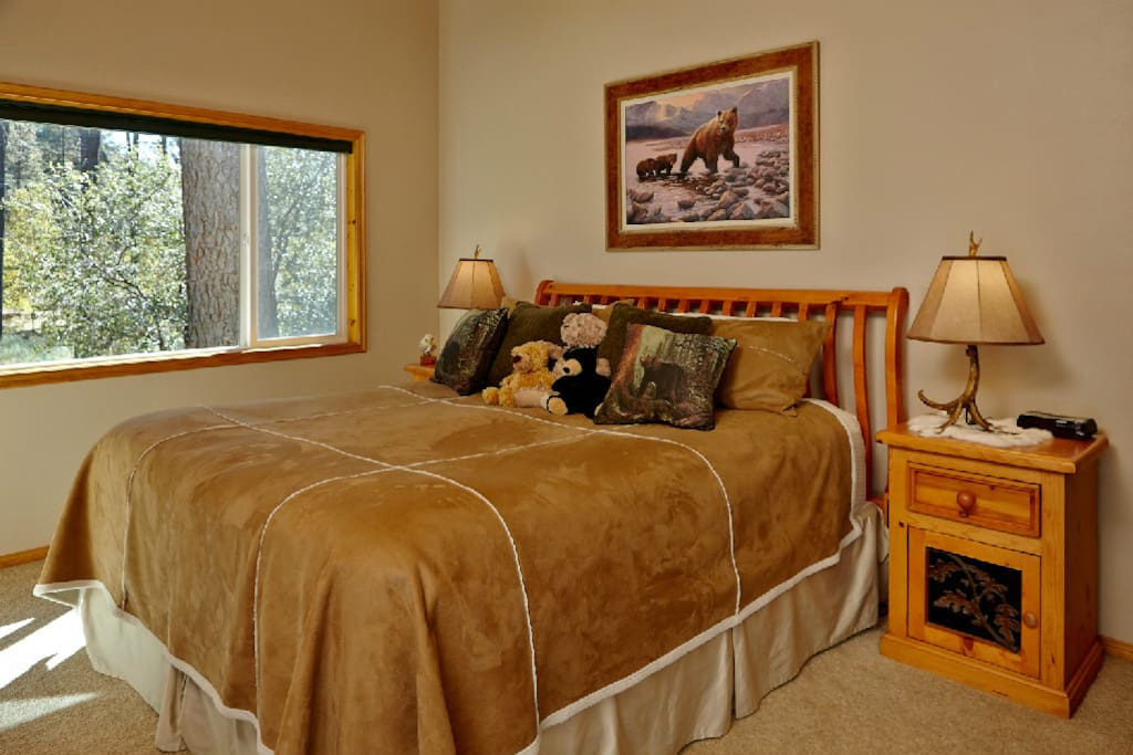 Master bedroom with warming blankets & nestled in the pines view