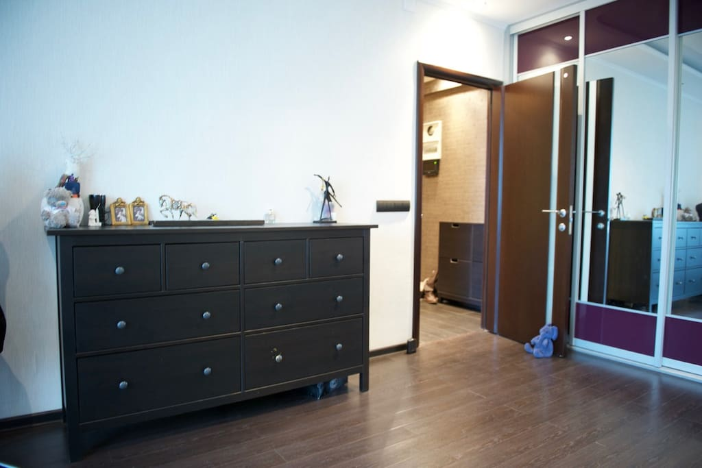Room with a wardrobe and chest of drawers