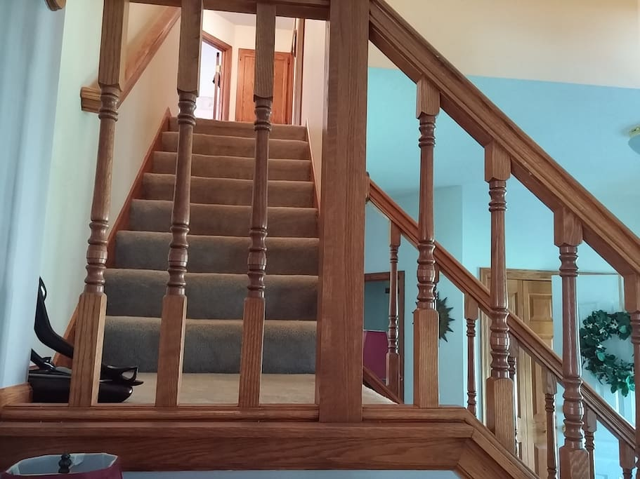 Your bedroom and bathroom are at the top of these stairs (bathroom to the left, your bedroom to the right).