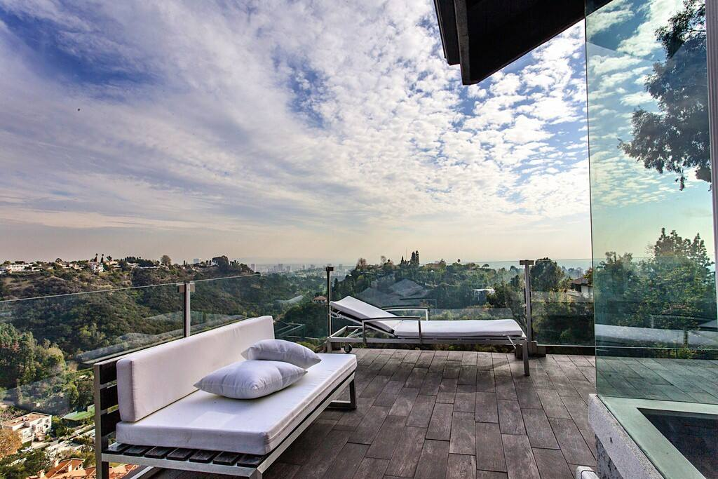 Canyon, city, and ocean views from large decks on all levels.