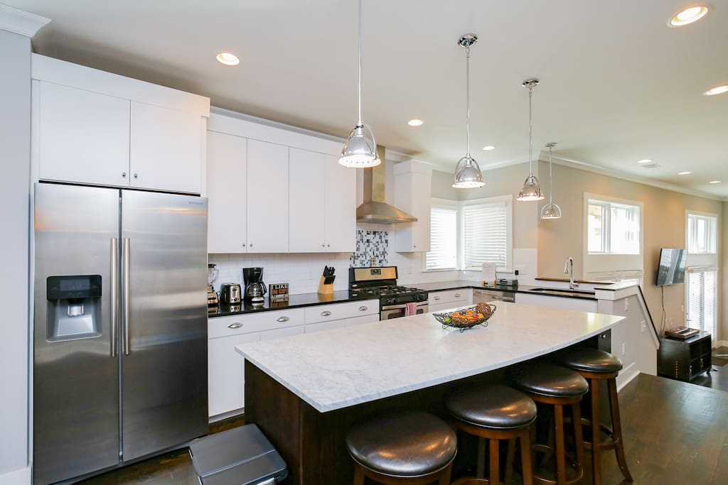 The kitchen has granite countertops and all new stainless steel appliances.