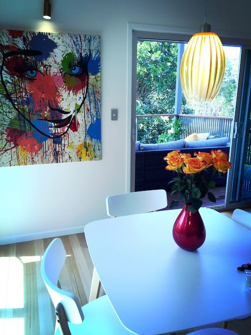The four seater dining table in the living areas upstairs... one of three dining areas available for this home