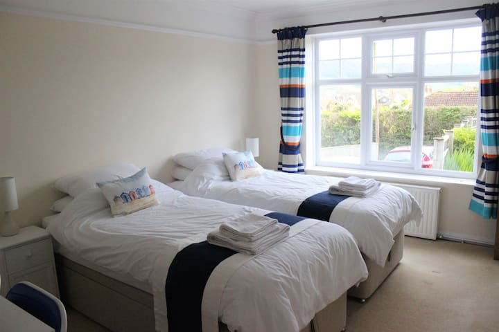 Bright, spacious twin room with private access.
