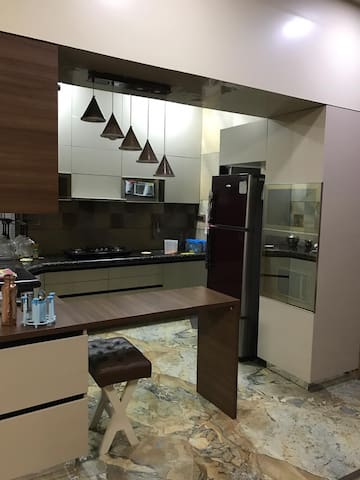 Kitchen with Fridge, Oven & Microwave for Vegetarians only.