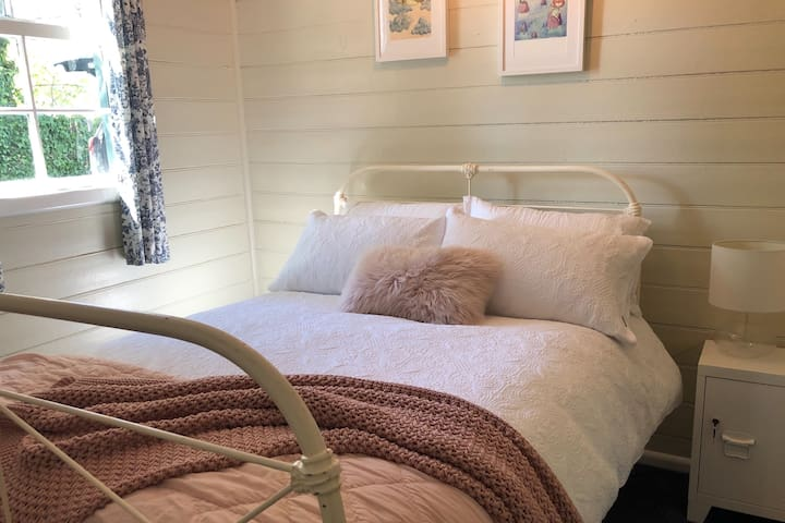 Ella's favourite room, with it's gorgeous vintage bed & of course a fluffy pink pillow for good measure