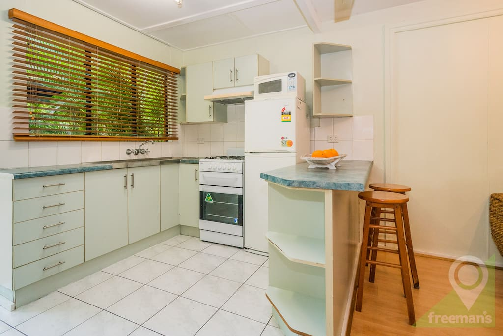 Self contained kitchen with breakfast bar