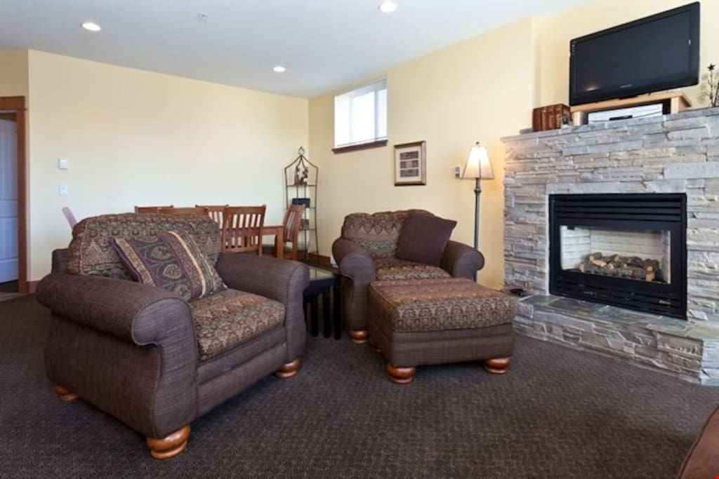 Take a seat in front of the fireplace after a long day on the slopes.