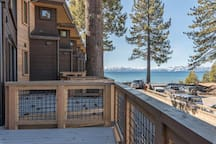 Enjoy the views of the tranquil pines and the gorgeous lake shore from the comfort of your deck.