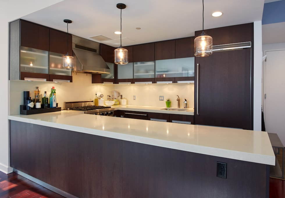 massive kitchen with plenty of counter space and cookware. Dishwasher and garbage disposal