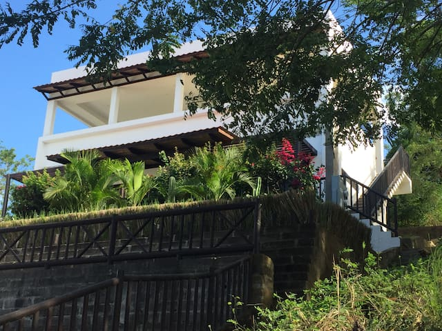 Newer home with upper terrace is an easy walk to beach and town