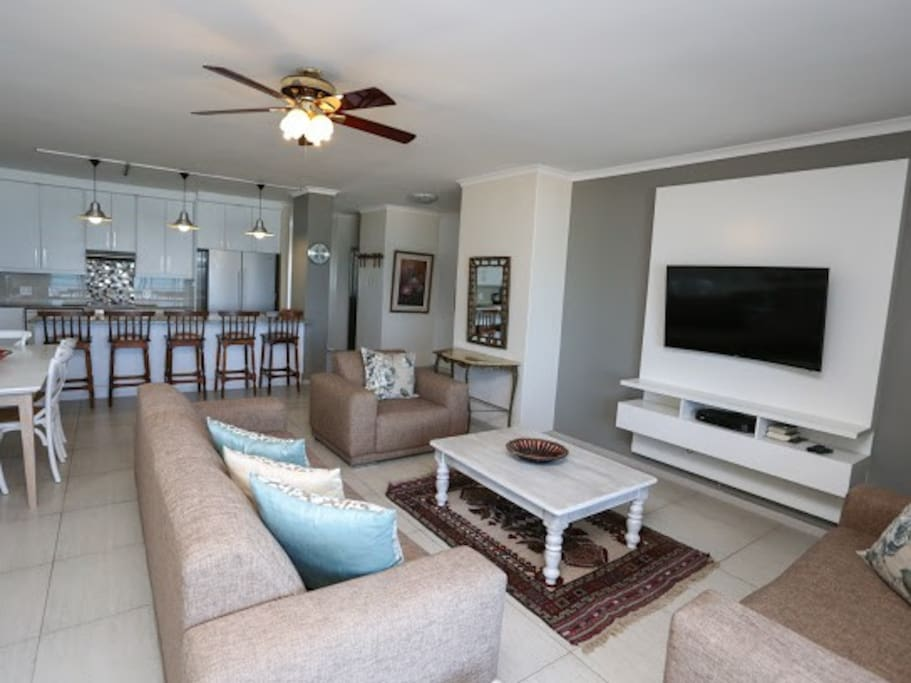 Open plan with kitchen(back), dining and living(TV)