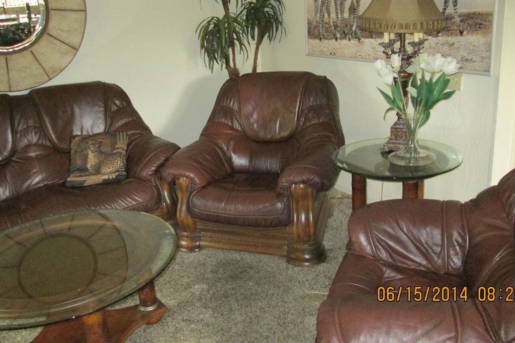 Newer leather chairs and sofa.