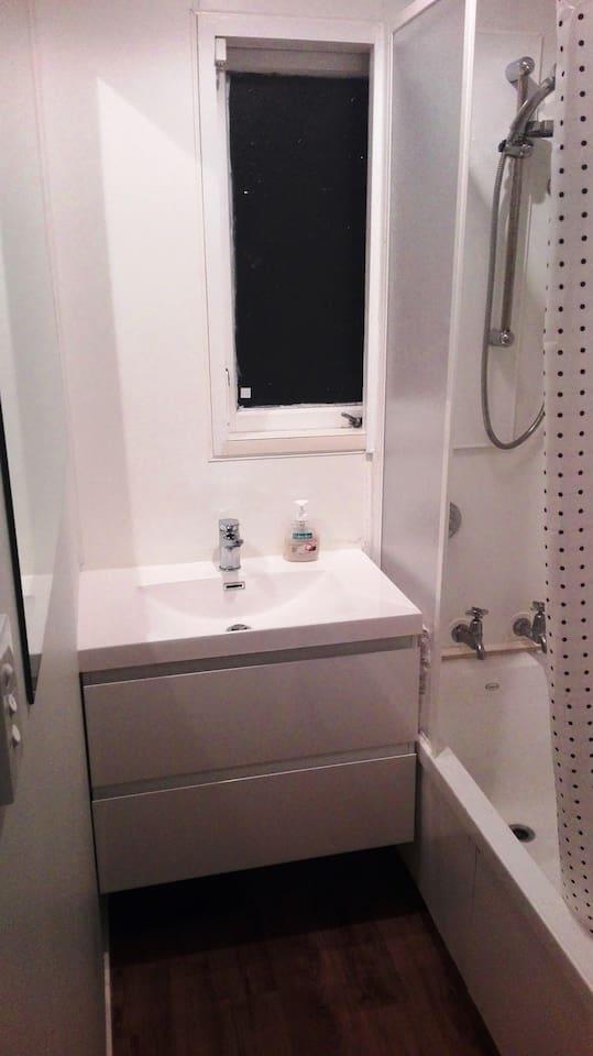 Clean bathroom with shower-bath