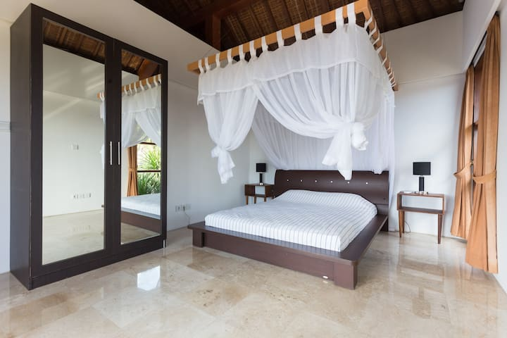 the lili room: large queen size bed and wardrobe