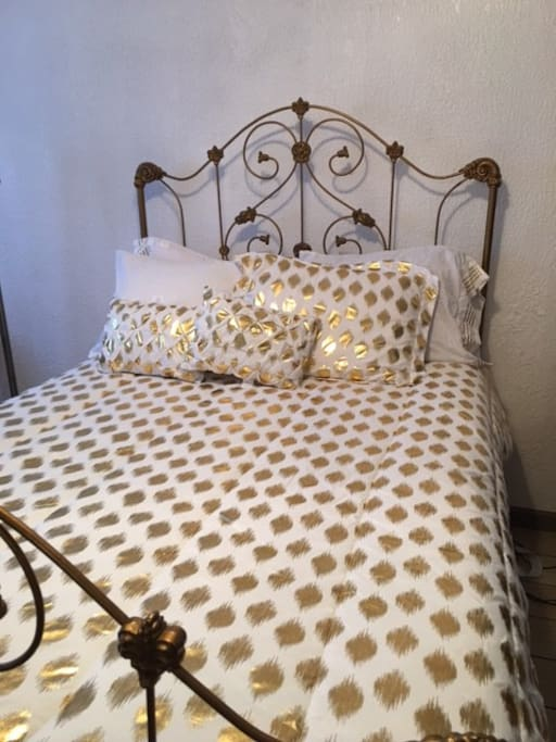 Full size bed with lovely antique headboard