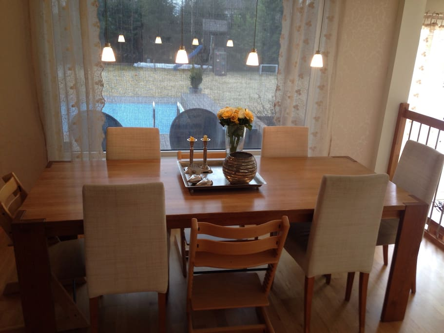 Dining area. We have 8 normal chair, 3 for kids and one bench. Can fit 12 adults and kids around the table :)