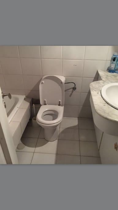 Bathroom with bath and toilet big mirror
