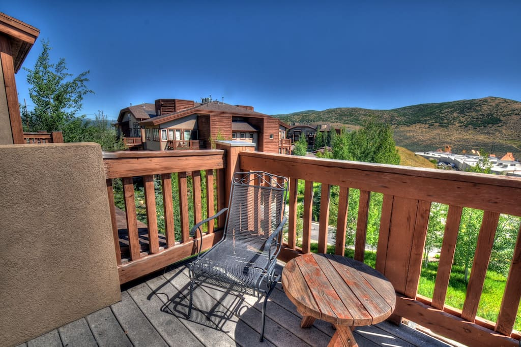 Breath in the Fresh Mountain Air and Enjoy the Views from the Balcony off of the Living Room
