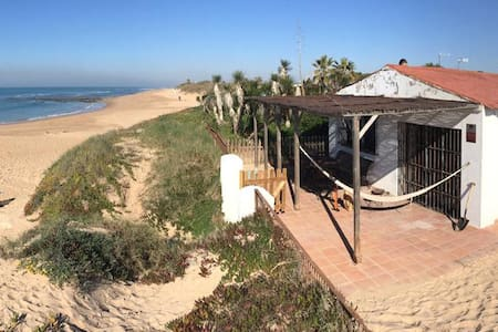 Rustic house right on the sand of the beach!