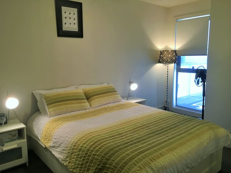 Main bedroom with queen size bed and wardrobe space.