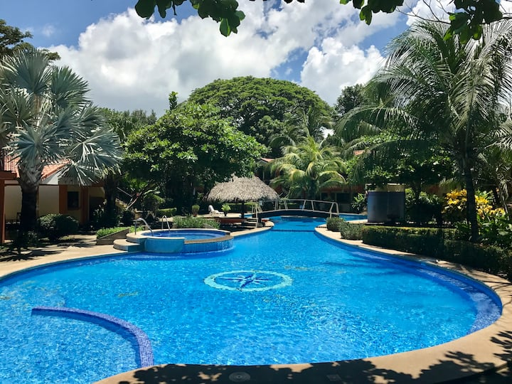 Flat surrounded by beautiful gardens and pool