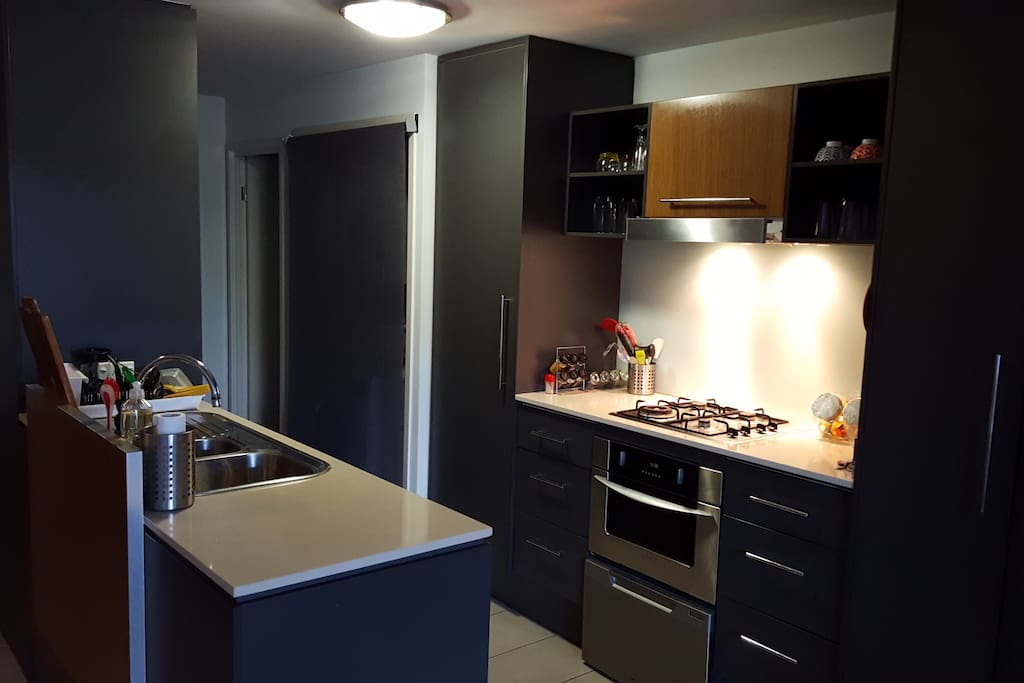 Bathroom and bedroom in the emporium apartments for - 1 bedroom apartment salt lake hawaii ...