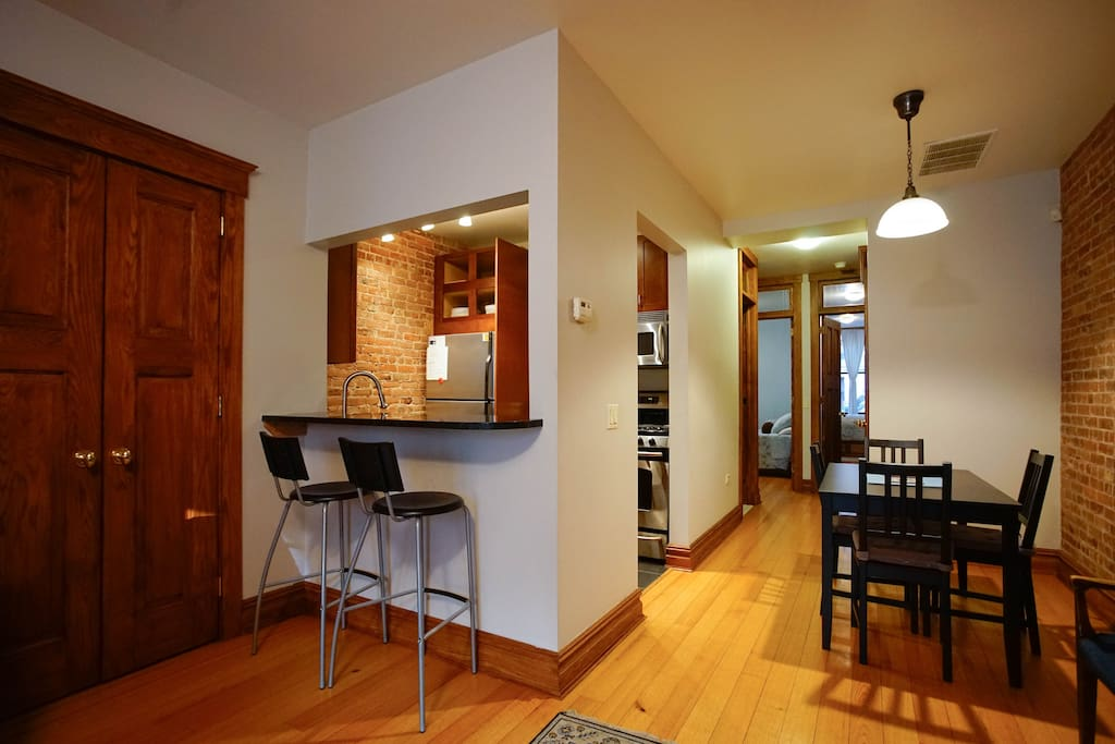 Dining table and breakfast bar.