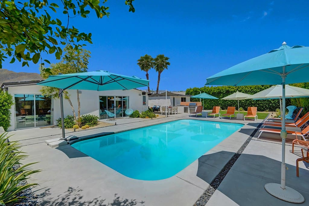 BACK OF HOUSE - SWIMMING POOL - ALEXANDER ON THE ROCKS - PALM SPRINGS VACATION RENTAL POOL HOME