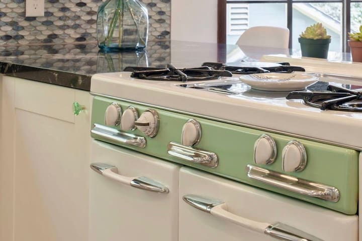 Modern kitchen with fully-refurbished 1940's oven and new, vintage-style appliances