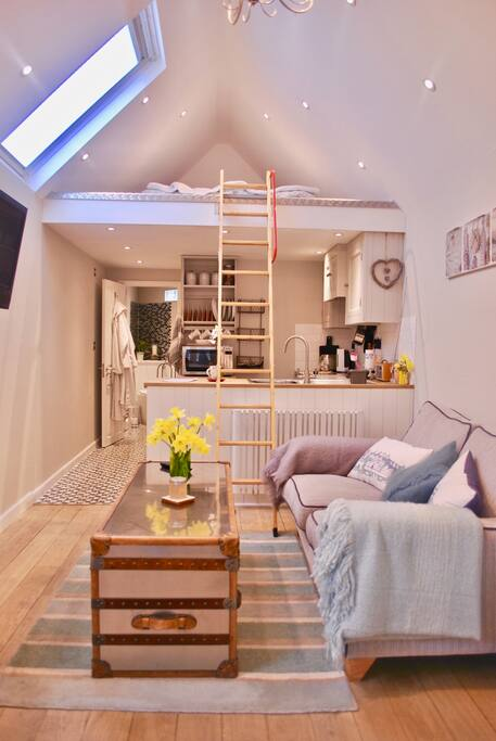 Ladder to mezzanine floor (at visitors risk, not suitable for elderly/infirm) with sunken Vi-spring bed, bedside lights and phone chargers