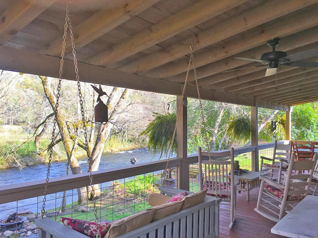 Picture yourself sitting here on the back porch swing or rockers enjoying Deep Creek and the birds!