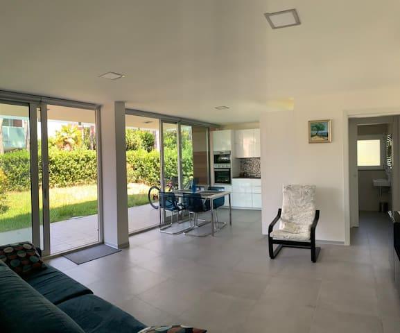Ground floor: living room and kitchen, garden view