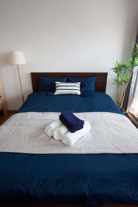 """Double bed (Size:140×200cm) """"We have one bath towel and one face towel per parson."""""""
