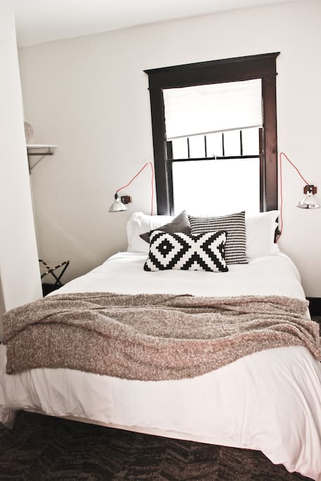 The 2nd bedroom is small, but comfortable w/ a queen sized matress.  (Side tables coming soon!)