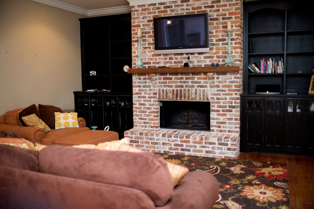 Living room with fireplace and built in cabinets