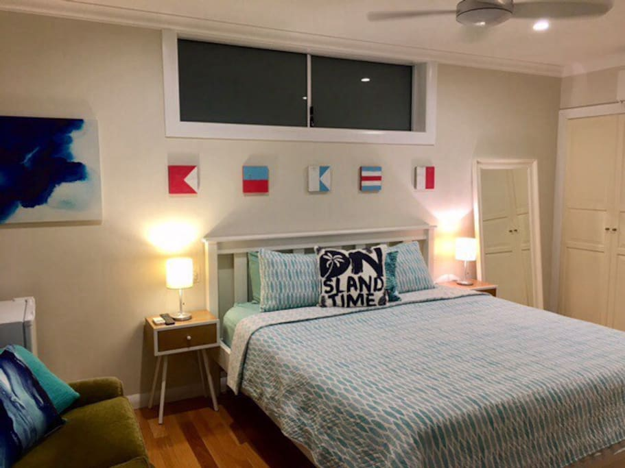 Spacious King bed room with coastal decor and pillow top mattress.