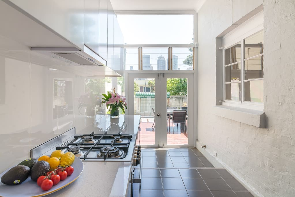 "Enjoy the open plan kitchen with panoramic views of the city skyline. ""We stayed at Paul's apartment ... and absolutely loved it! It's got everything you could need & the best view out to the city from the outside deck.""- Carly Staunton *****"