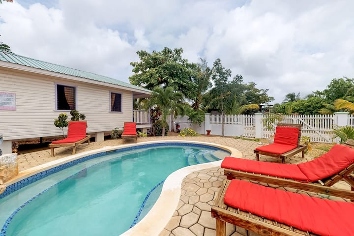 Cabana with a porch and a hammock, view of the pool & shared grill area