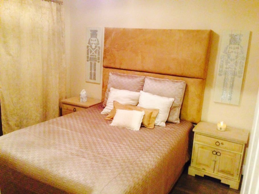 Queen Bedroom with Dramatic oversized head board.  Room dimensions 10.6 ft by 9.7 ft