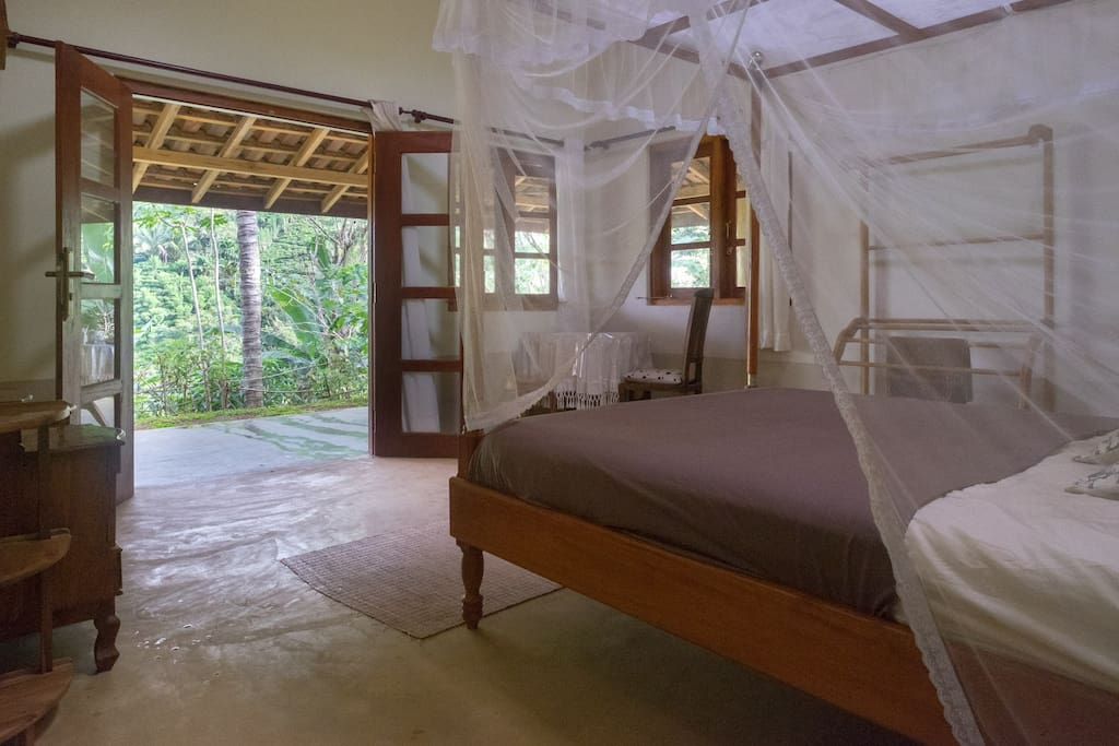 View from bed to veranda and surrounding