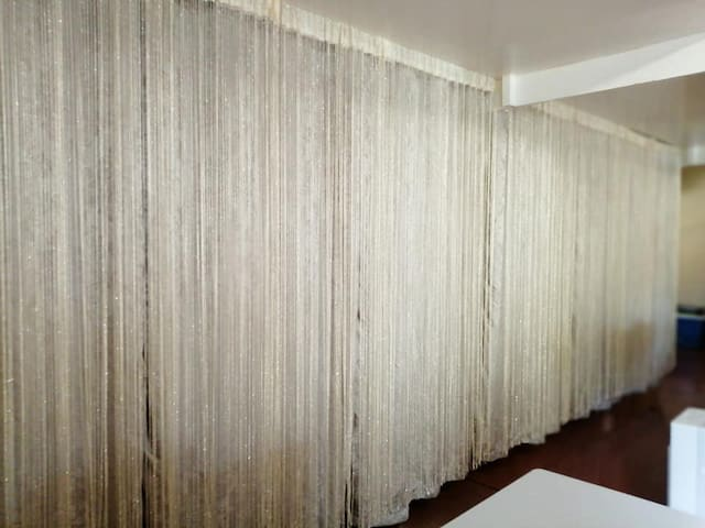 Curtains dividing the napping area and the sala.