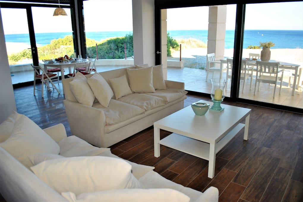 Open plan sitting room/kitchen/dining room with 180 degrees sea view!