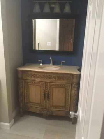The vanity is hand carved with a granite top.