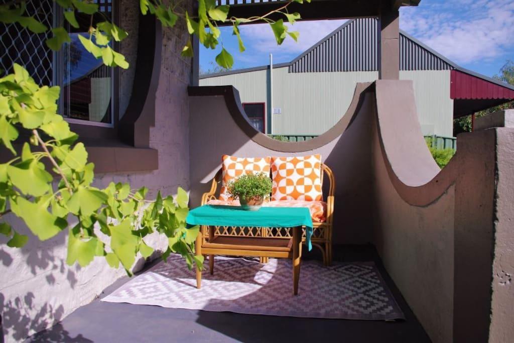 Enjoy the morning sunshine on the front veranda.
